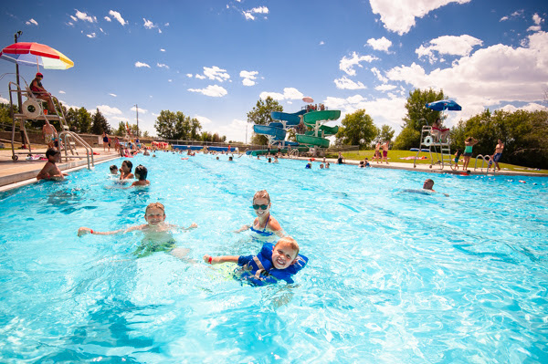 Two children swim with their mother at a water park in Great Falls, MT