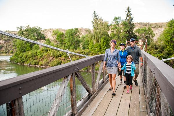 A family travels across a bridge in Great Falls, MT