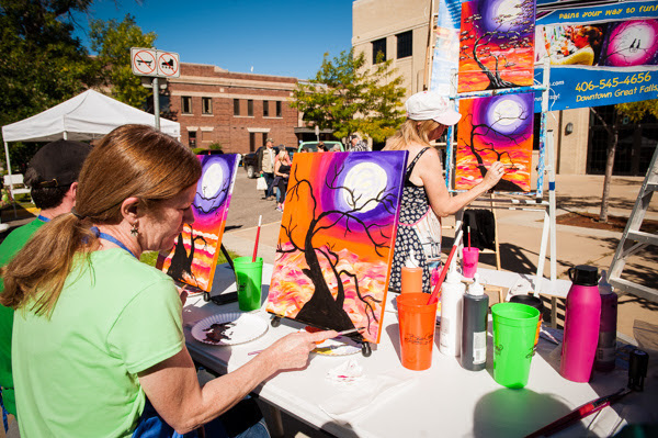 A woman paints a picture at an event in Great Falls, MT