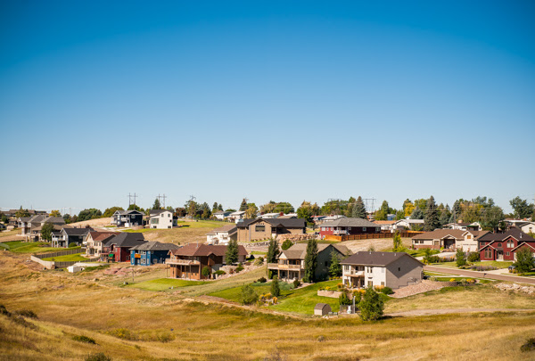 A neighborhood of houses sits in a valley in Great Falls, MT